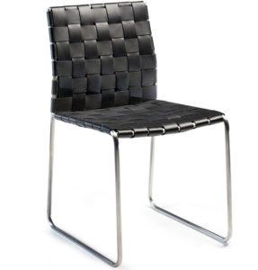 köksstol med dyna i skinn / läder och underrede i metall.
